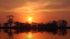 Ambient orange sunset reflections Stock Footage