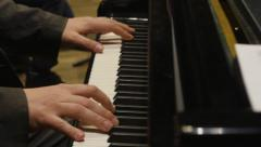 Pianist plays on piano in orchestra rehearsal. End of the song. Dolly shot - stock footage