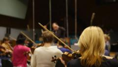 Conductor and orchestra on rehearsal. Working in sound studio Stock Footage