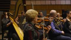 MOSCOW, CIRCA 2014: Orchestral musicians perform music in studio rehearsal. Pano Stock Footage