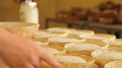 Тaking baskets with the risen dough from the table - stock footage