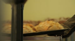 Changing in place of trays wih bread in the oven - stock footage