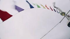 Colorful flags whipping in wind - stock footage