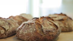 Placing of the ready bread on the table - stock footage