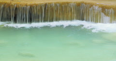 Smooth flowing water over cascade to clean natural pond. Seamless loop-able vid Stock Footage