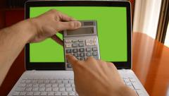 Calculator in front of a laptop Stock Footage