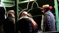 4K night view of gondoliers on gondola station Stock Footage