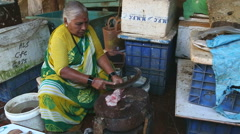 Indian woman chopping fish at a market stand in Mumbai. Stock Footage