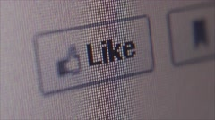 Social Media Macro Close Up: Cursor licking Facebook 'Like' button Stock Footage
