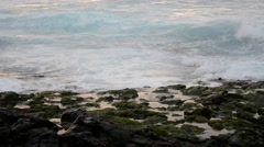 Waves hitting rocks on the shore Stock Footage