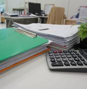 Office supply and paperwork in workplace - stock photo