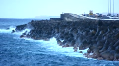 Waves crashing on the breakwater Stock Footage