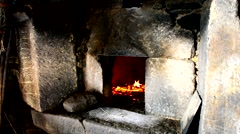 Stone oven heating up, preparing to bake bread Stock Footage