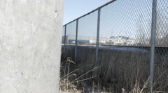 Pillar and fence looking at building in distance -slider shot Stock Footage