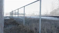 Pillar and fence under bridge- Angled slider shot Stock Footage