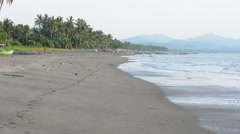 People walking on the long beach in Malandog in Philippines Stock Footage