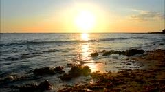 Sun reflecting off the sea on a beach, Puerto Sherry, Cadiz, Spain Stock Footage