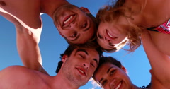 Friends playing beach volleyball Stock Footage