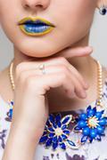 Fashion Yellow, Blue Sexy Lips and Closeup. Make up concept - stock photo