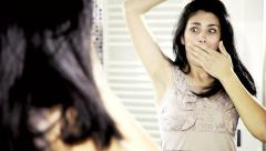 Woman desperate about long armpits hair Stock Footage