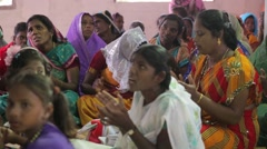 Indian women singing and clapping at church Stock Footage