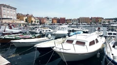 Boats moored in centre of Rovinj - stock footage