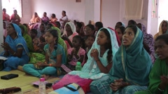 Indian women and girls sitting on floor and singing - stock footage