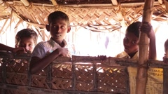 Indian kids staying under a braided roof Stock Footage
