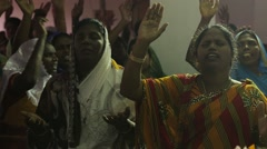 Indian people praying at church - stock footage