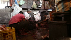 Indian men at the butchery in Mumbai. - stock footage