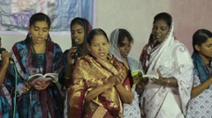 Indian women singing in church Stock Footage