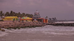 Hinduism Temple on the ocean's shoreline - stock footage