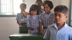Indian girls hugging and waving at school Stock Footage