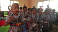 Indian children waving at school Stock Footage