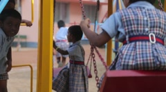 Little Indian girl swinging in a swing - stock footage
