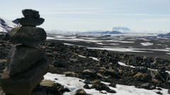 Lava stones and snowy landscape with Askja volcano in Iceland Stock Footage