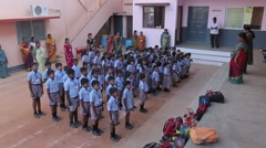Indian kids singing with their teachers - stock footage
