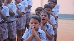 Indian boys praying placed in a line Stock Footage