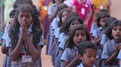 Indian kids in uniforms praying - stock footage