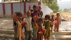 India kids with watermelon in ther hands waving Stock Footage