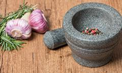 Mortar and pestle with pepper and spices Stock Photos