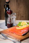 Fresh salmon fillet with aromatic herbs, spices Stock Photos