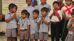 Little Indian boys folding hands for prayer at school Stock Footage