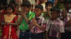 Indian kids praying - stock footage