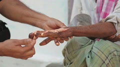 Indian man with leprosy hamds in India Stock Footage