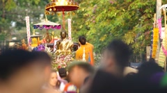 People spray holy water to the Buddha statue Stock Footage