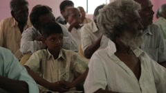 Indian man and a boy sitting down and listening in India - stock footage