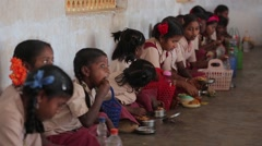 Little Indian girls eating at school in India Stock Footage