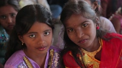 Little Indian girls in red and purple dresses in India Stock Footage