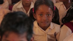 Little Indian girl with ponytails and hair clips in India - stock footage